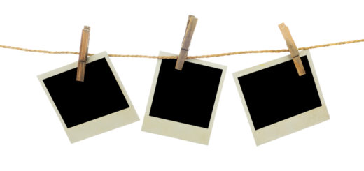 Three blank instant photos hanging on the clothesline. Isolated on white background.